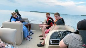 Young adults on a boat ride