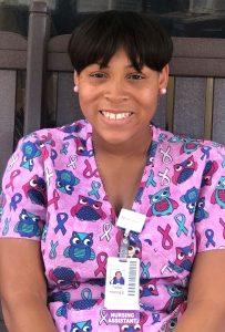 Young woman wearing nursing badge