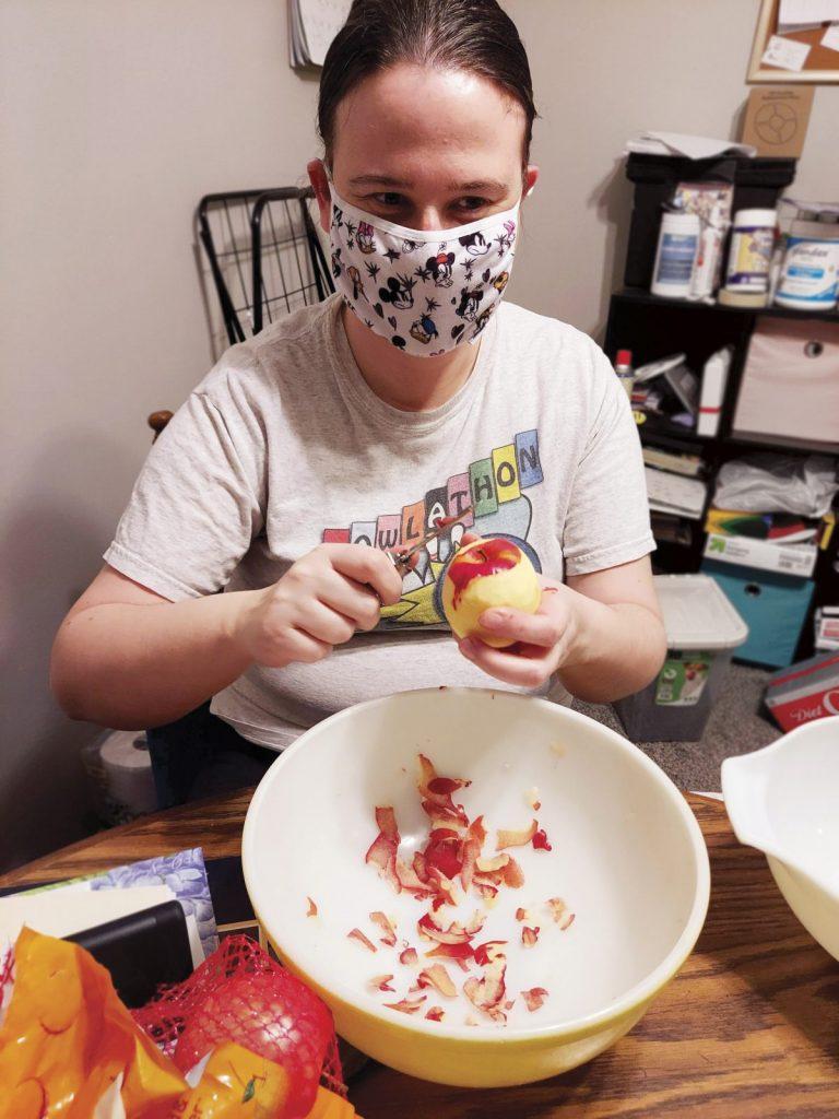 Kristen peeling an apple