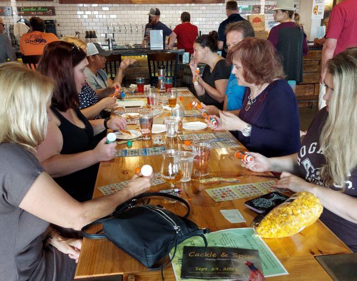 Table full of people playing bingo.