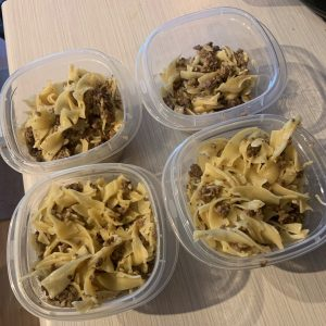 James's beef stroganof in clear, plastic containers.
